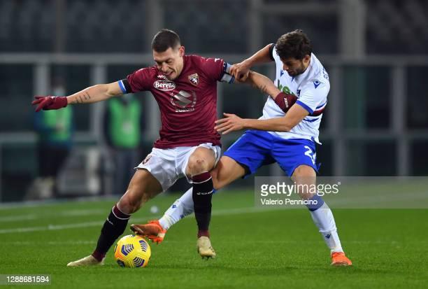Andrea Belotti of Torino F.C. Battles for possession with Bartosz Bereszynski of U.C. Sampdoria during the Serie A match between Torino FC and UC...