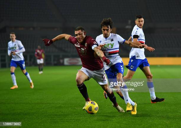 Andrea Belotti of Torino F.C. Battles for possession with Tommaso Augello of U.C. Sampdoria during the Serie A match between Torino FC and UC...