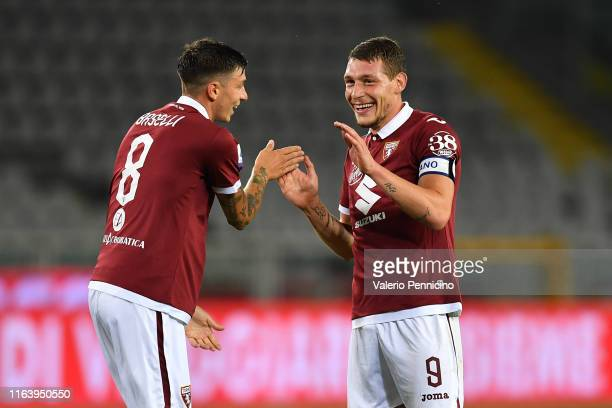 Andrea Belotti of Torino FC celebrates a goal with team mate Daniele Baselli during the Serie A match between Torino FC and US Sassuolo at Stadio...