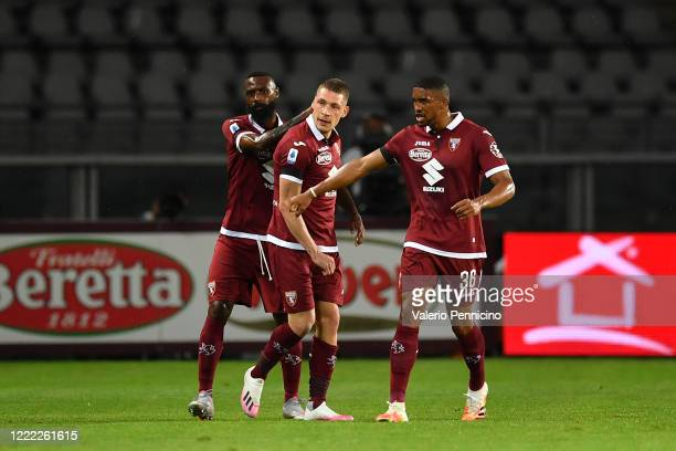 Andrea Belotti of Torino FC celebrates the opening goal with team mates Nicolas Nkoulou and Gleison Bremer during the Serie A match between Torino FC...
