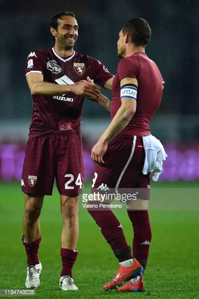 Andrea Belotti of Torino FC celebrates victory with team mate Emiliano Moretti at the end of the Serie A match between Torino FC and UC Sampdoria at...