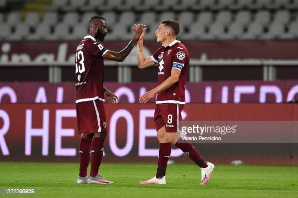 Andrea Belotti of Torino FC celebrates victory with team mate Nicolas Nkoulou at the end of the Serie A match between Torino FC and Udinese Calcio at...