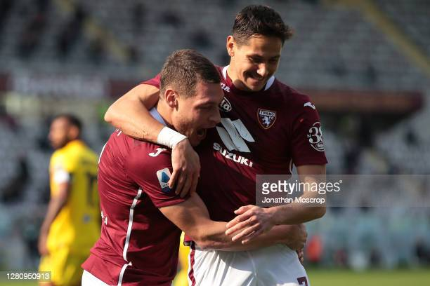 Andrea Belotti of Torino FC celebrates with team mate Sasa Lukic after scoring from the penalty spot to give the side a 10 lead during the Serie A...