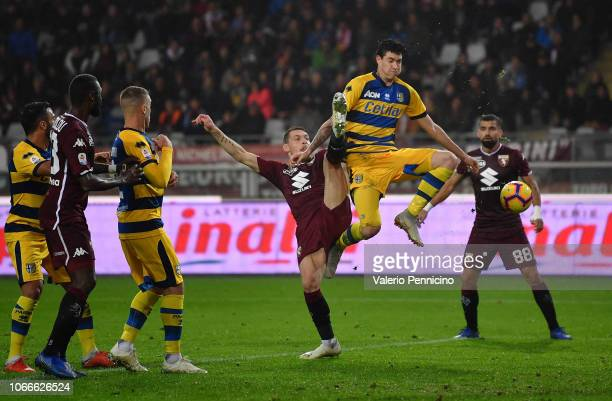 Andrea Belotti of Torino FC clashes with Alessandro Bastoni of Parma Calcio during the Serie A match between Torino FC and Parma Calcio at Stadio...