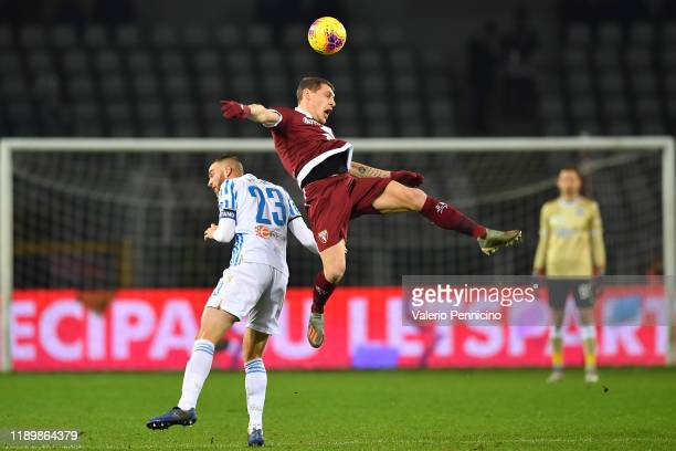 Andrea Belotti of Torino FC clashes with Francesco Vicari of SPAL during the Serie A match between Torino FC and SPAL at Stadio Olimpico di Torino on...