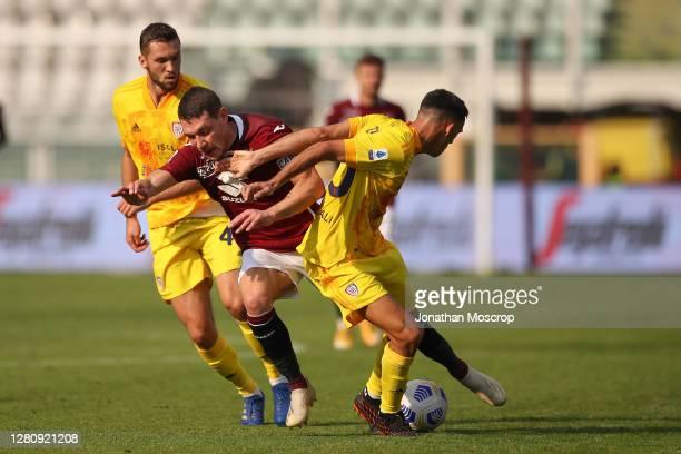 Andrea Belotti of Torino FC clashes with Gabriele Zappa and Sebastian Walukiewicz of Cagliari during the Serie A match between Torino FC and Cagliari...
