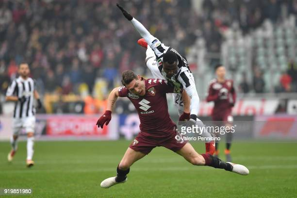 Andrea Belotti of Torino FC clashes with Kwadwo Asamoah of Juventus during the Serie A match between Torino FC and Juventus at Stadio Olimpico di...