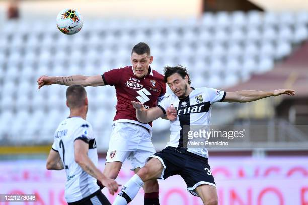 Andrea Belotti of Torino FC clashes with Matteo Darmian of Parma Calcio during the Serie A match between Torino FC and Parma Calcio at Stadio...
