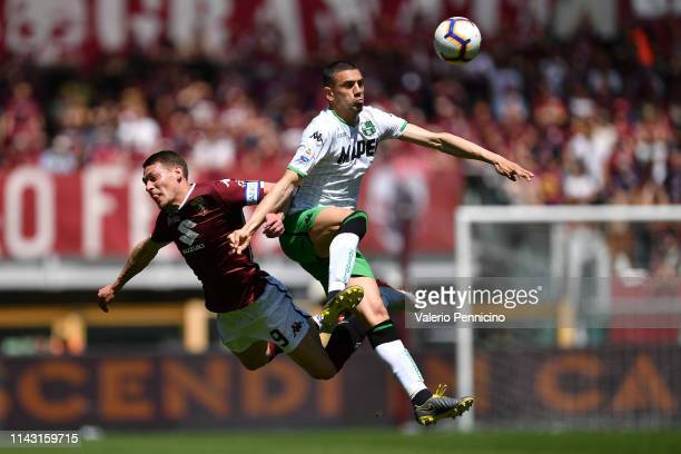 Andrea Belotti of Torino FC clashes with Merih Demiral of US Sassuolo during the Serie A match between Torino FC and US Sassuolo at Stadio Olimpico...