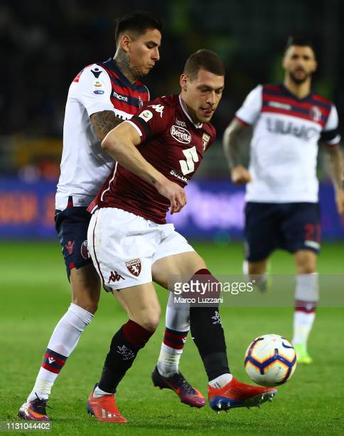 Andrea Belotti of Torino FC competes for the ball with Erick Pulgar of Bologna FC during the Serie A match between Torino FC and Bologna FC at Stadio...