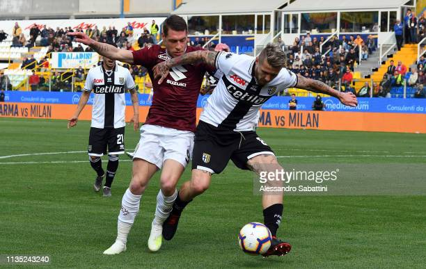 Andrea Belotti of Torino FC competes for the ball with Juraj Kucka of Parma Calcio during the Serie A match between Parma Calcio and Torino FC at...