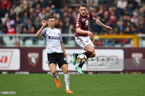 Andrea Belotti of Torino FC competes with Ivan Perisic of FC Internazionale during the Serie A match between Torino FC and FC Internazionale at...