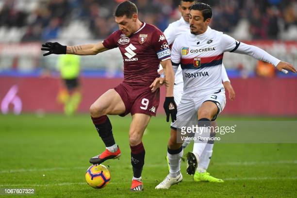 Andrea Belotti of Torino FC competes with Koray Gunter of Genoa CFC during the Serie A match between Torino FC and Genoa CFC at Stadio Olimpico di...