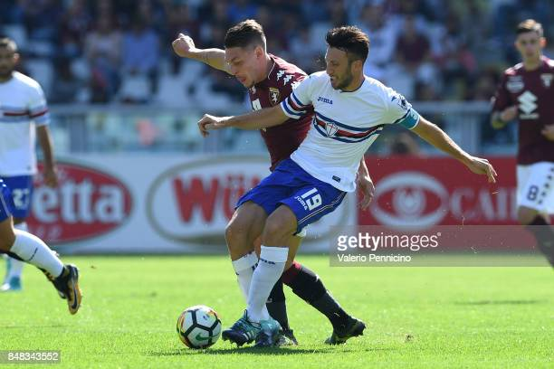 Andrea Belotti of Torino FC competes with Vasco Regini of UC Sampdoria during the Serie A match between Torino FC and UC Sampdoria at Stadio Olimpico...