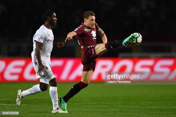 Andrea Belotti of Torino FC controls the ball against Cristian Zapata of AC Milan during the Serie A match between Torino FC and AC Milan at Stadio...
