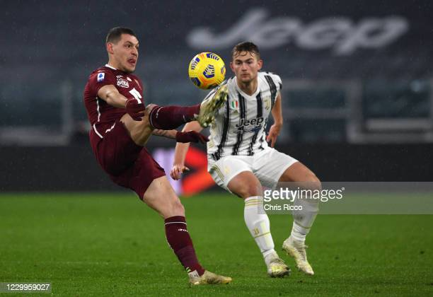 Andrea Belotti of Torino FC evades challenge from Matthijs de Ligt of Juventus during the Serie A match between Juventus and Torino FC at Allianz...