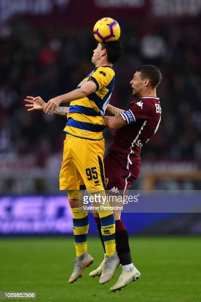 Andrea Belotti of Torino FC goes up with Alessandro Bastoni of Parma Calcio during the Serie A match between Torino FC and Parma Calcio at Stadio...