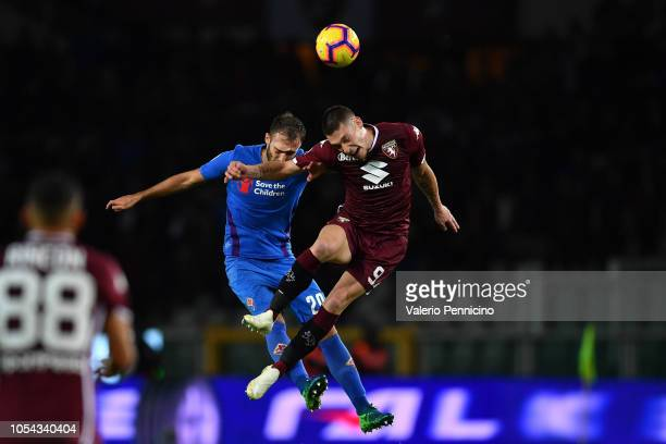 Andrea Belotti of Torino FC goes up with Dusan Vlahovic of ACF Fiorentina during the Serie A match between Torino FC and ACF Fiorentina at Stadio...