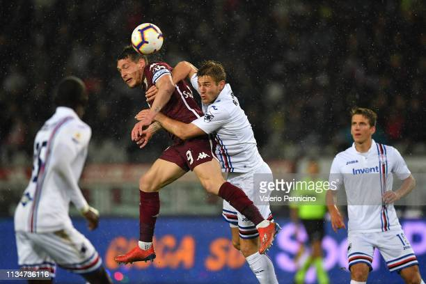 Andrea Belotti of Torino FC goes up with Joachim Andersen of UC Sampdoria during the Serie A match between Torino FC and UC Sampdoria at Stadio...