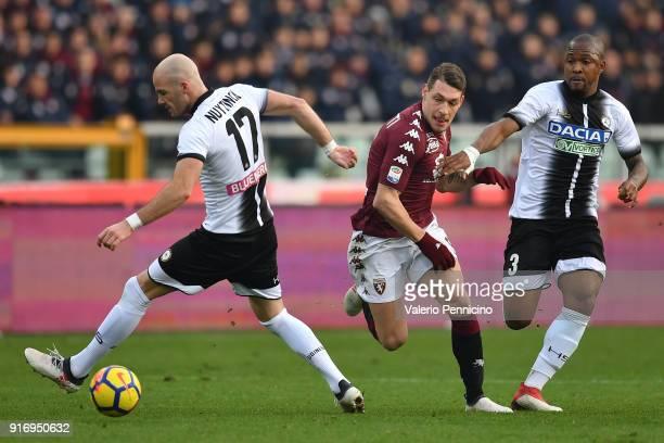 Andrea Belotti of Torino FC in action against Caetano De Souza Santos Samir and Bram Nuytinck of Udinese Calcio during the Serie A match between...