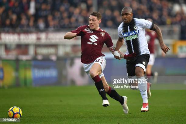 Andrea Belotti of Torino FC in action against Caetano De Souza Santos Samir of Udinese Calcio during the Serie A match between Torino FC and Udinese...