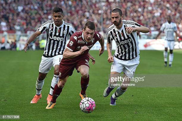 Andrea Belotti of Torino FC in action against Leonardo Bonucci and Alex Sandro of Juventus FC during the Serie A match between Torino FC and Juventus...