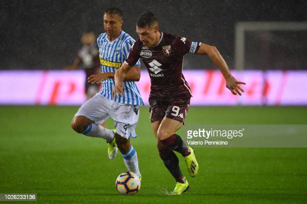 Andrea Belotti of Torino FC in action against Thiago Cionek of SPAL during the Serie A match between Torino FC and SPAL at Stadio Olimpico di Torino...