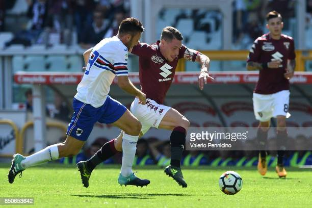Andrea Belotti of Torino FC in action against Vasco Regini of UC Sampdoria during the Serie A match between Torino FC and UC Sampdoria at Stadio...