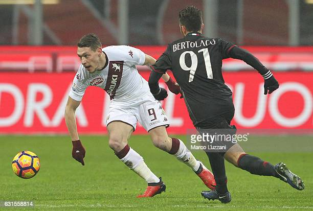 Andrea Belotti of Torino FC is challenged by Andrea Bertolacci of AC Milan during the TIM Cup match between AC Milan and AC Torino at Giuseppe Meazza...