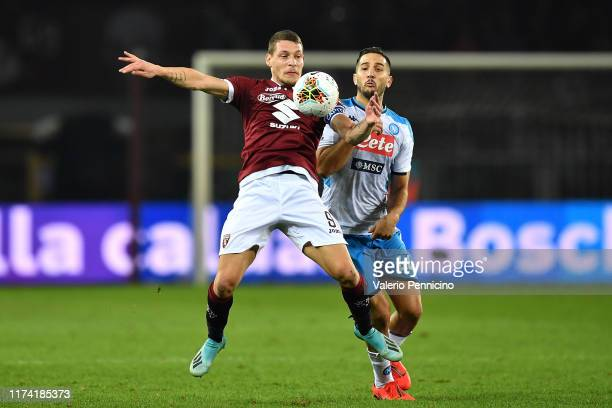 Andrea Belotti of Torino FC is challenged by Konstantinos Manolas of SSC Napoli during the Serie A match between Torino FC and SSC Napoli at Stadio...