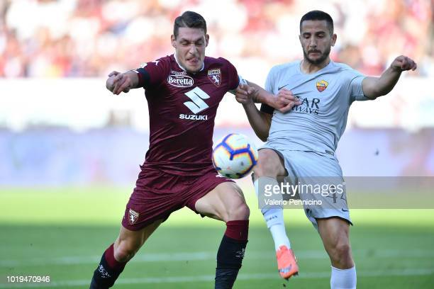 Andrea Belotti of Torino FC is challenged by Kostas Manolas of AS Roma during the Serie A match between Torino FC and AS Roma at Stadio Olimpico di...