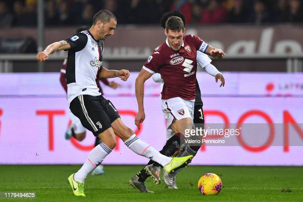 Andrea Belotti of Torino FC is challenged by Leonardo Bonucci of Juventus during the Serie A match between Torino FC and Juventus at Stadio Olimpico...