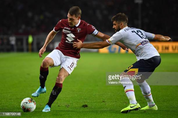 Andrea Belotti of Torino FC is challenged by Luca Rossettini of US Lecce during the Serie A match between Torino FC and US Lecce at Stadio Olimpico...