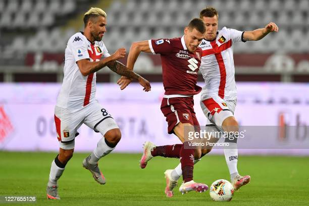 Andrea Belotti of Torino FC is challenged by Lukas Lerager and Valon Behrami of Genoa CFC during the Serie A match between Torino FC and Genoa CFC at...