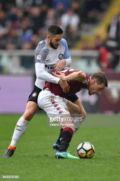 Andrea Belotti of Torino FC is challenged by Roberto Gagliardini of FC Internazionale during the Serie A match between Torino FC and FC...