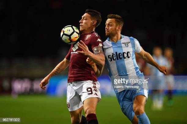 Andrea Belotti of Torino FC is challenged by Stefan De Vrij of SS Lazio during the Serie A match between Torino FC and SS Lazio at Stadio Olimpico di...