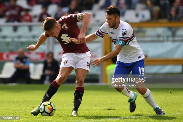 Andrea Belotti of Torino FC is challenged by Vasco Regini of UC Sampdoria during the Serie A match between Torino FC and UC Sampdoria at Stadio...
