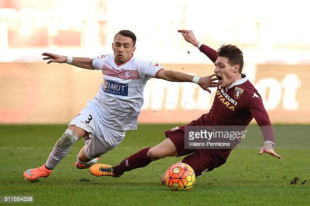 Andrea Belotti of Torino FC is tackled by Gaetano Letizia of Carpi FC during the Serie A between Torino FC and Carpi FC at Stadio Olimpico di Torino...
