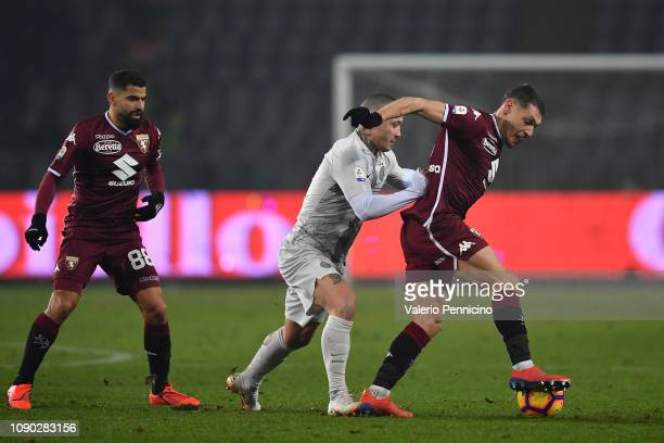 Andrea Belotti of Torino FC is tackled by Radja Nainggolan of FC Internazionale during the Serie A match between Torino FC and FC Internazionale at...