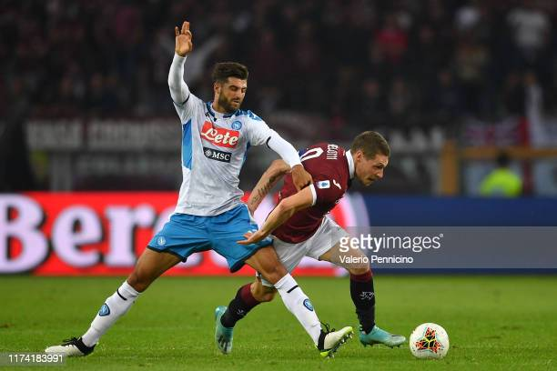Andrea Belotti of Torino FC is tackled by Sebastiano Luperto of SSC Napoli during the Serie A match between Torino FC and SSC Napoli at Stadio...