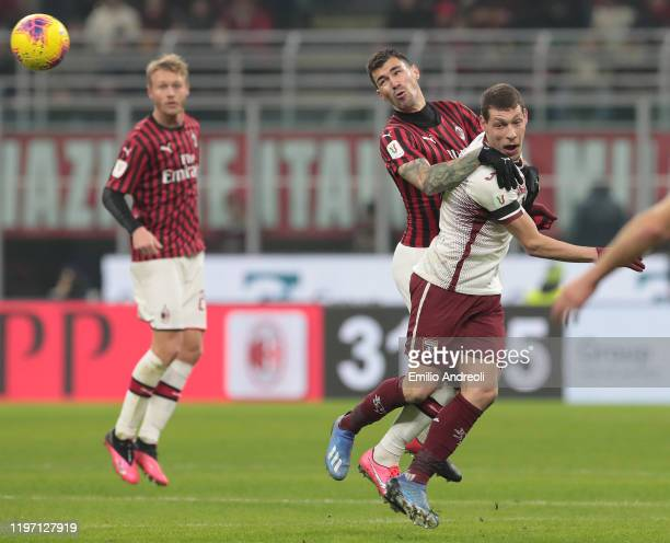 Andrea Belotti of Torino FC jumps for the ball against Alessio Romagnoli of AC Milan during the Coppa Italia Quarter Final match between AC Milan and...
