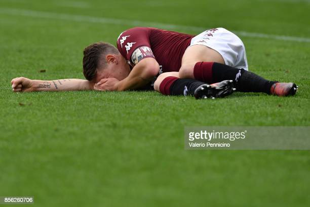 Andrea Belotti of Torino FC lies injured during the Serie A match between Torino FC and Hellas Verona FC at Stadio Olimpico di Torino on October 01...