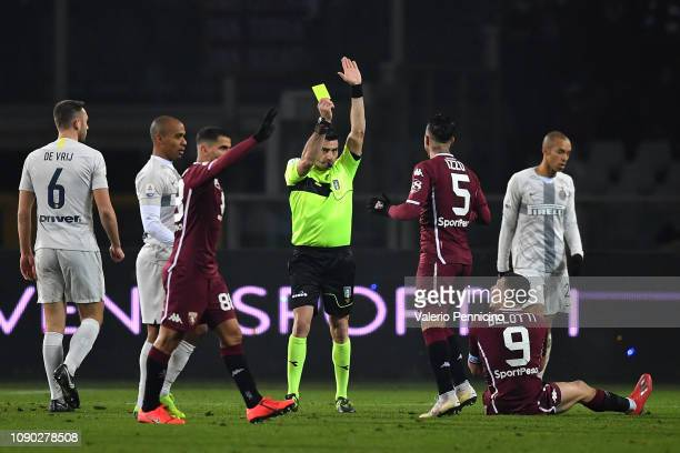 Andrea Belotti of Torino FC receives the yellow card from referee during the Serie A match between Torino FC and FC Internazionale at Stadio Olimpico...