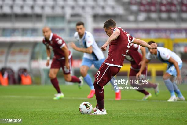 Andrea Belotti of Torino FC scores his goal from the penalty spot during the Serie A match between Torino FC and SS Lazio at Stadio Olimpico di...