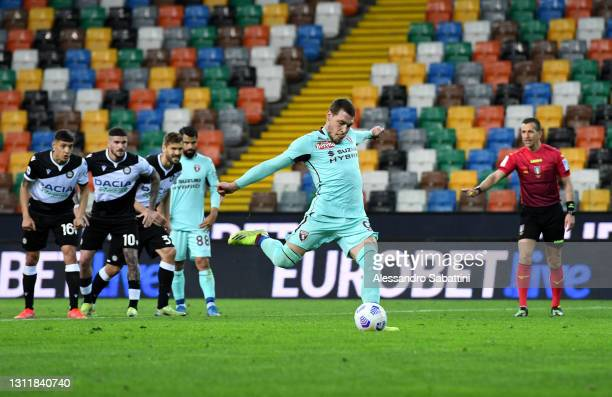 Andrea Belotti of Torino FC scores their side's first goal from the penalty spot during the Serie A match between Udinese Calcio and Torino FC at...