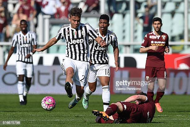 Andrea Belotti of Torino FC tackles Paulo Dybala of Juventus FC during the Serie A match between Torino FC and Juventus FC at Stadio Olimpico di...
