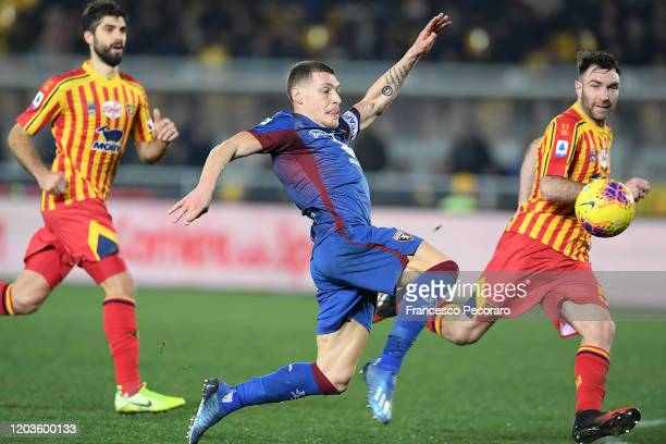 Andrea Belotti of Torino FC vies with Fabio Lucioni of US Lecce during the Serie A match between US Lecce and Torino FC at Stadio Via del Mare on...