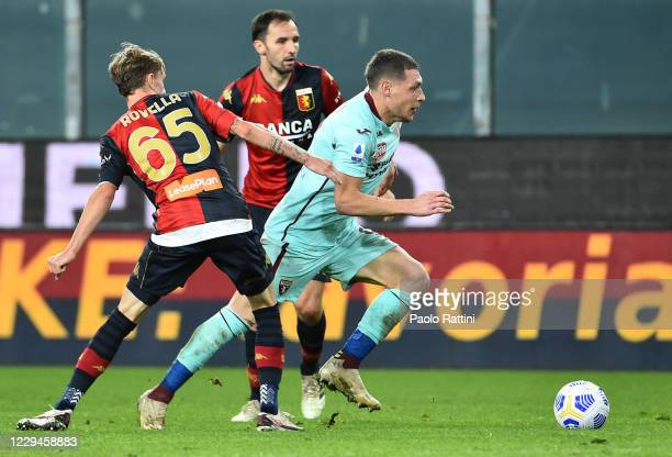 Andrea Belotti of Torino FC with Nicolò Rovella and Milan Badelj of Genoa CFC during the Serie A match between Genoa CFC and Torino FC at Stadio...