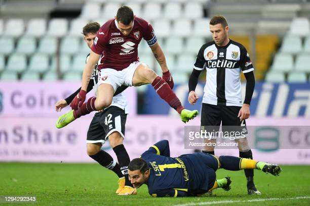 Andrea Belotti of Torino strides over Luigi Sepe of Parma as he collects the ball during the Serie A match between Parma Calcio and Torino FC at...