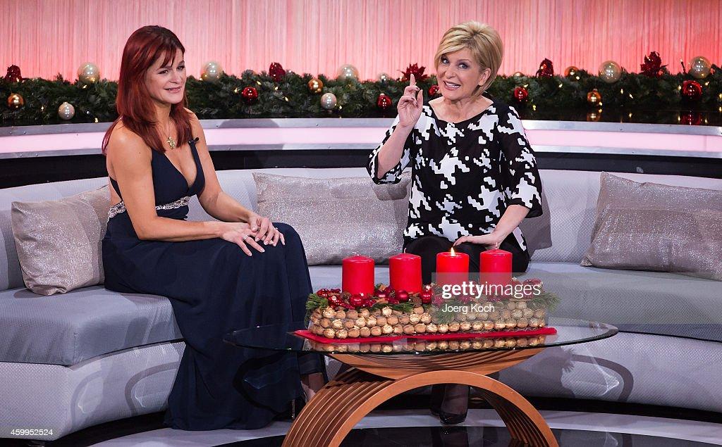 Andrea Berg and Carmen Nebel attend the TV show 'Die schönsten Weihnachtshits' on December 4, 2014 in Munich, Germany.